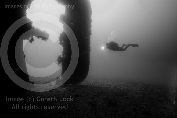 That diver is behind the rudder of a merchant vessel in the Fjord at Narvick