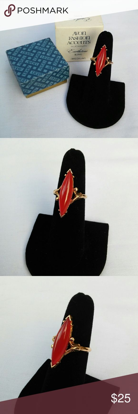 Vintage 1979 Faux Carnelian Ring New with Box Vintage ring with a large marquise shaped red/ orange stone by AVON Earthstone Line. Costume Jewelry Stone is glass & mimics the look of carnelian. Band is gold tone & self-adjusting with two metal tabs on the inside of the band to give you a perfect fit! 1979 is the exact year this particular design was produced. A lovely retro piece of statement costume jewelry. New in original box. Length of stone - 1 1/8inches. Adjustable fit from about a…