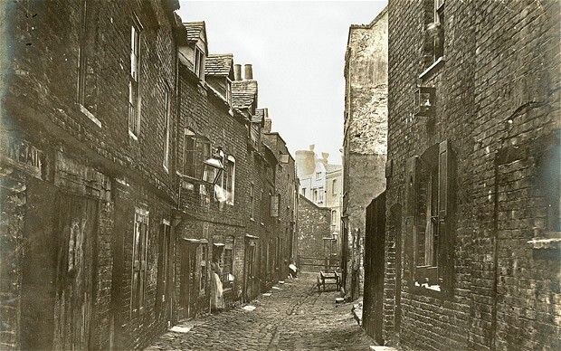 Lower Fore Street, a narrow cobblestoned street in Lambeth, pictured in 1865. Fore Street is shown on John Roque's map of 1746. It ran alongside the river between Vauxhall Gardens and Lambeth Palace.