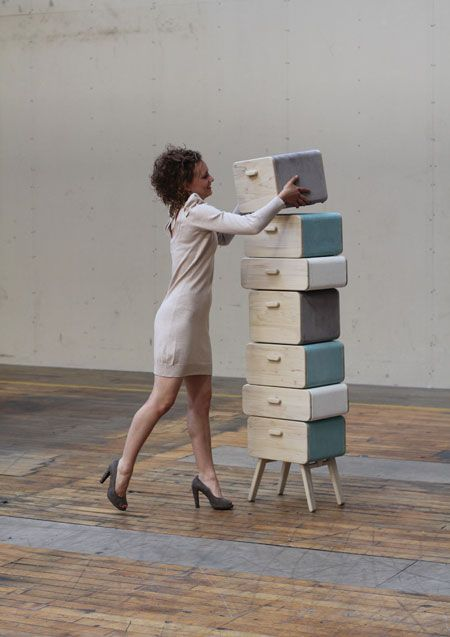 A stack of separate storage components with legs that fold out, turning drawers into stools.