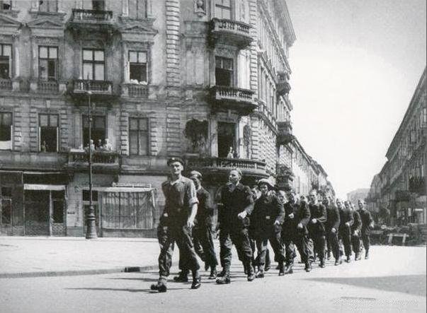 Warsaw Uprising: Insurgent column on corner of Chmielna and Szpitalna ...