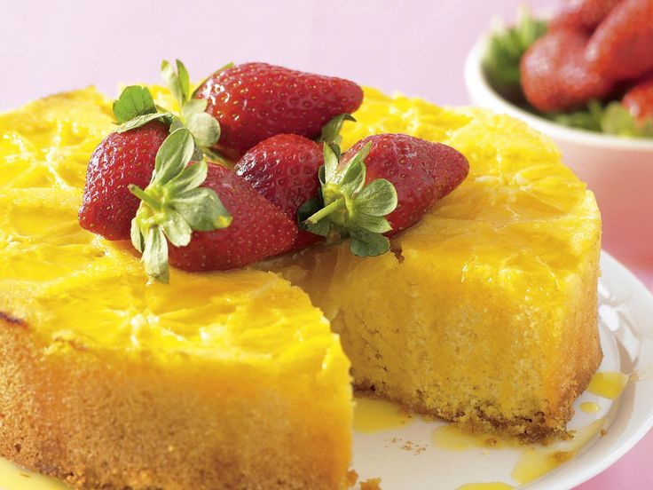 Wonderfully moist, this glorious cake is topped with real orange pieces and drizzled with a sweet, orange syrup. Serve this cake warm, topped with fresh strawberries, for a divine dessert.