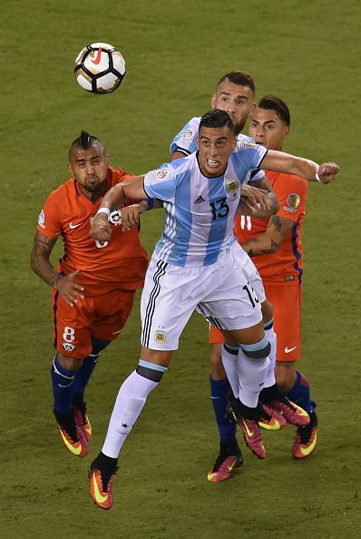 #COPA2016 #COPA100 Argentina's Ramiro Funes Mori heads the ball next to Chile's Arturo Vidal during the Copa America Centenario final in East Rutherford New Jersey...