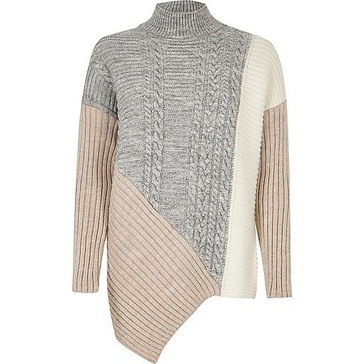 Mid weight cable knit Contrast ribbed panels Turtleneck Long sleeve Asymmetric hem