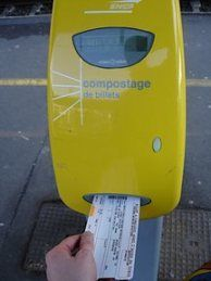 This is a picture of someone getting their train ticket stamped. In order to even get on the train you MUST have your ticket stamped. This is a very important part while trying to travel by train.