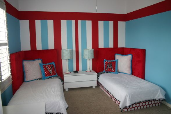 Olivias red, white and blue room!!, Red, white, and blue stripes anchor the room with twin beds hugging the walls to help give more floor space.  Custom bedding, monogrammed pillows and zebra accents all work together to create a fun play environment!, Girls Rooms Design
