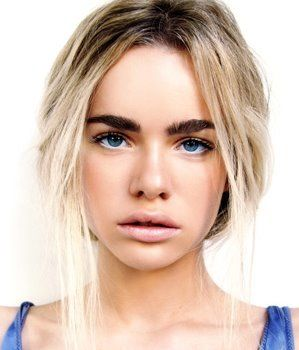 Dark, bushy brows are totally possible with light hair. Creates an intense look.