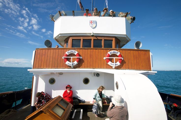 Passengers aboard the historic steam tug William C. Daldy en route to Kawau Island
