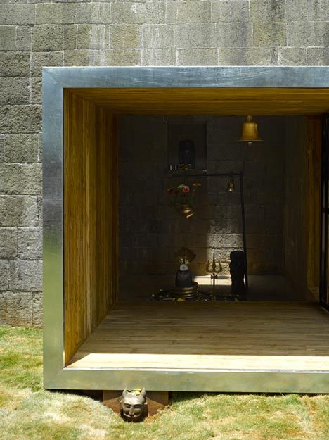 Largely open doorway, only way light enters building besides small skylight at top of structure.