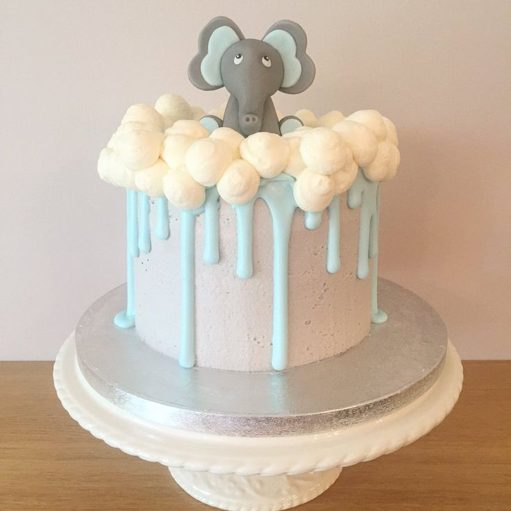 Baby shower cake in grey buttercream with blue royal icing drip and fondant elephant
