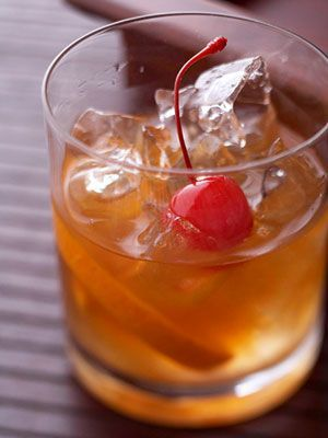 An orange slice, sugar, and bitters are combined in a glass before bourbon is added to create this traditional cocktail.
