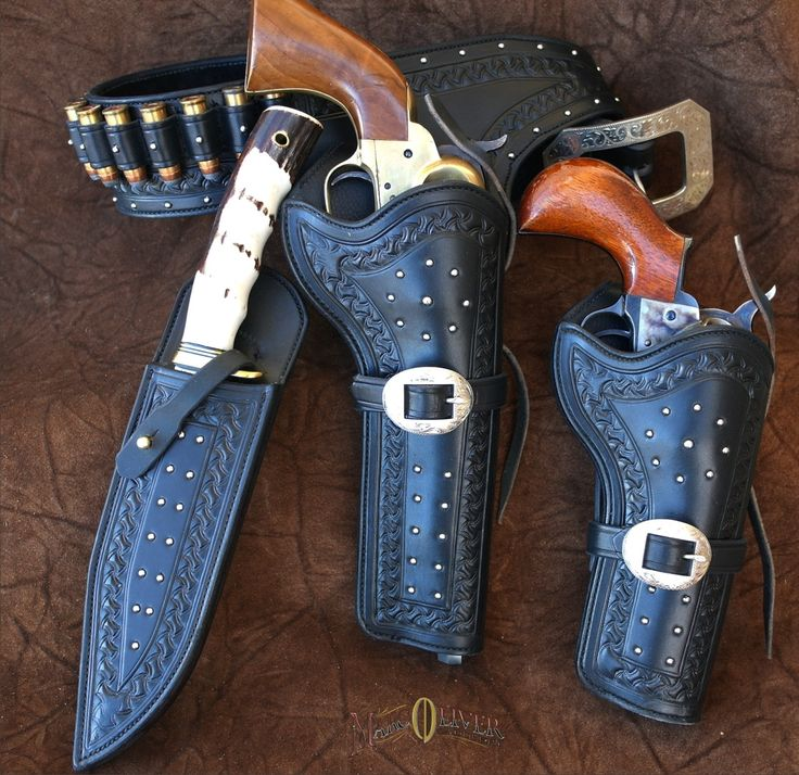 This striking rig features buskedero style gunbelt with 18 loops, right draw holster, cross draw holster and knife sheath. Engraved buckles...