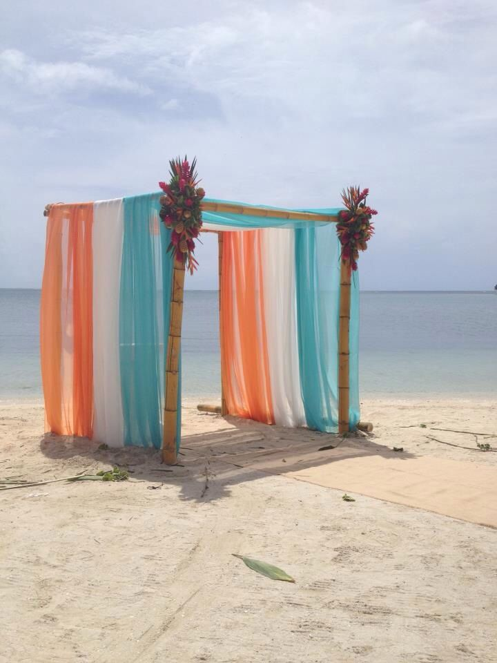 Orange & turquoise beach wedding-Sit back, relax, and let C2C Travels coordinate your destination wedding travels for you! info@c2ctravels.com