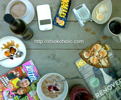 That's how our  #breakfast table on a Saturday morning look like.  me with my #Singaporean half boiled egg and #kopi si totally #kopitiam style, so #shiok my mobil and a #asian magazine. Andreas with his #swedish breakfast #Kalleskavi and #egg, #allbarn #cereal and #coffee and of course some #DIY #magazine. That's so us in a #mixed #culture family.by #shiokoholic