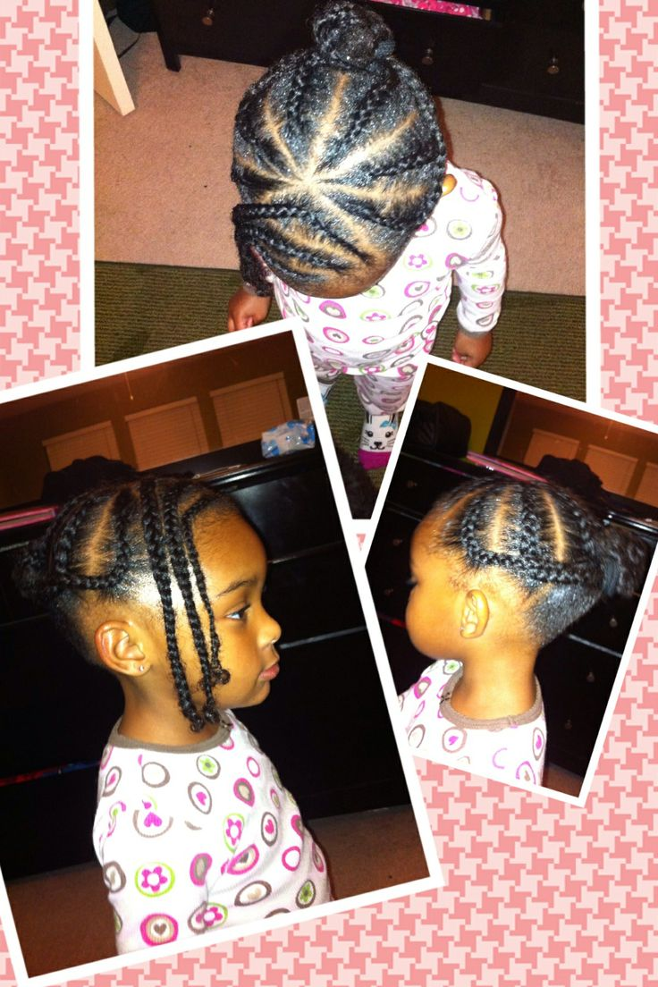 Braids into a bun in back. Also side braided bang. Natural hairstyles for kids