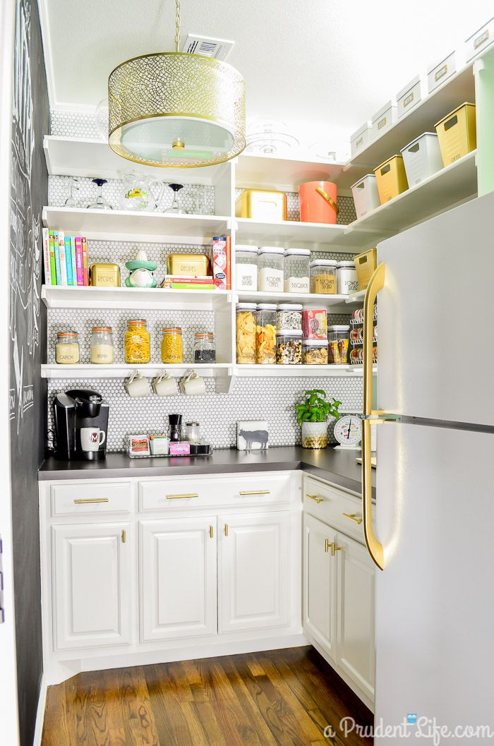This dreamy walk-in pantry has tons of organizing ideas that can work in any size space and on any budget.You won't believe which bins came from the dollar store! Check out the full post to learn more.