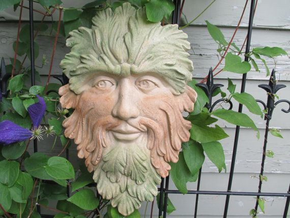 Hand designed using a non hardening clay, then molded into a hard copy cast plaster and hand cast using a fine sand and cement mix and finished with a mineral color to bring out his natural patina.This is my version of a classic piece from the green man collections. He looks so
