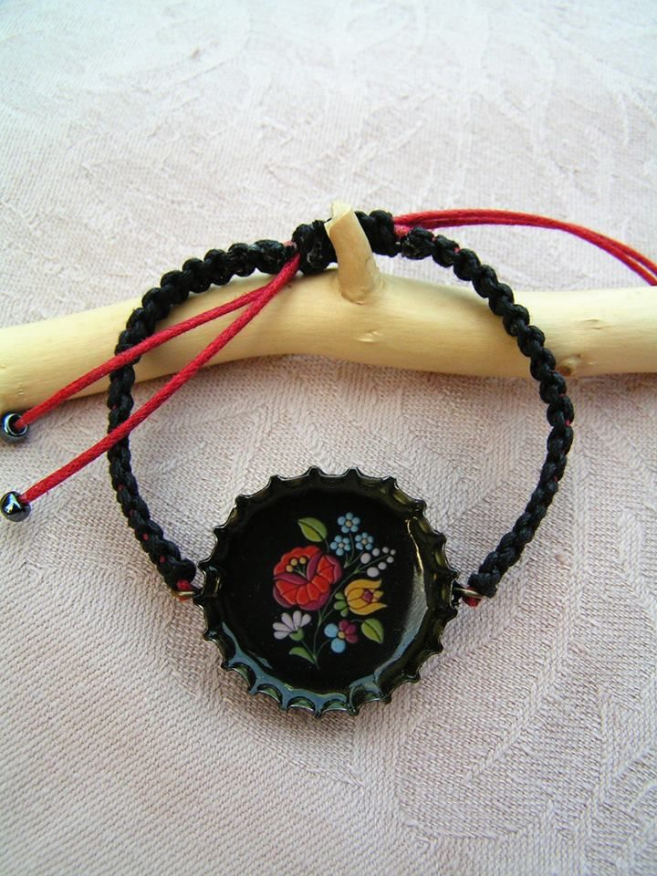"The famous ""Kalocsa"" folk motifs in a simple and sexy red-and-black, adjustable size macrame bracelet."