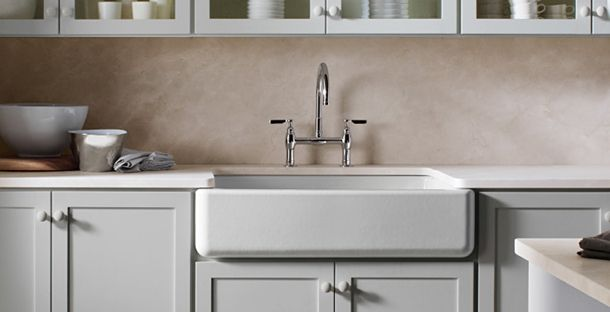 farmhouse sink. ash-blue cabinet and washed out walls. Interior ...