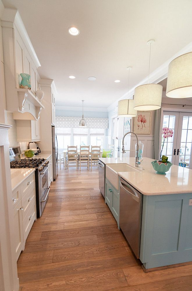 open kitchen living room floor plan pictures%0A White kitchen with blue island paint color  Kitchen pendants are Jamie  Young Custom Drum Pendant Lights  White perimeter kitchen with blue island  paint