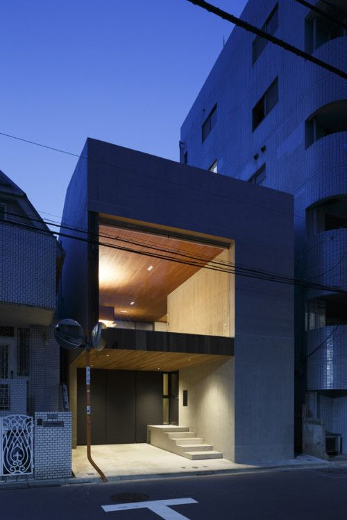 Frame is a minimalist house located in Tokyo, Japan, designed by APOLLO Architects and Associates. The home is characterized by a monolith exposed concrete volume with a large panoramic window situated on the front facade cantilevered over parking space. (3)