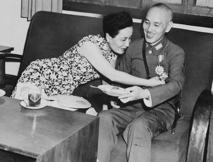 Madame Chiang Kai-shek (Soong May Ling), wife of China's generalissimo and acting president, looks at the Legion of Merit medal which Chiang received at Chunking, China from Lt. Gen. Joseph W. Stilwell, American commander in the China, Burma, and India theaters, Aug. 3, 1943.
