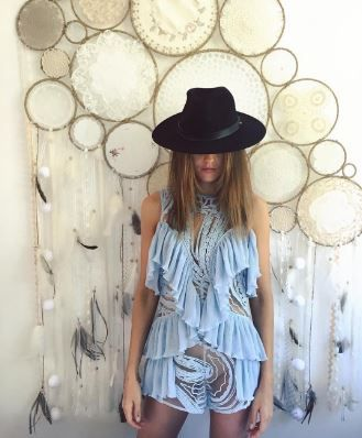 Isabel Lucas in the You're So Young So Have Fun Girl playsuit