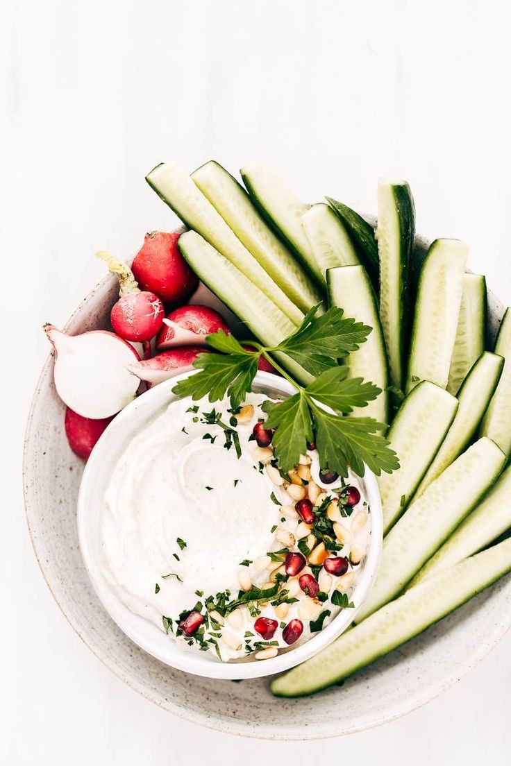 This garlicky tahini yogurt sauce is the best condiment to drizzle on roasted veggies or to serve along with meat. #recipe #dressing #sauce #tahini #yogurt #dip