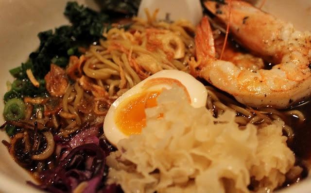 Prawn ramen bowl with egg, scallions, nori, and cabbage at Momofuku Noodle Bar, NYC.