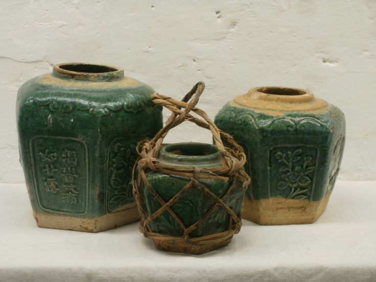 Small, medium and large green glazed ginger jars. The top is kept free from glaze to alow the cover to be fired on top of the jar. The cover serves as a shelve to stack the next pot in the kiln.