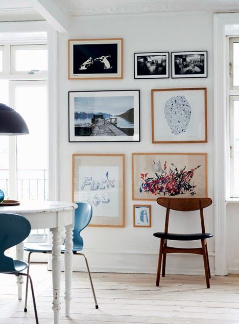 A dining room is a good place to have a hanging wall, a place for all your favourite pictues, to brighten the area.