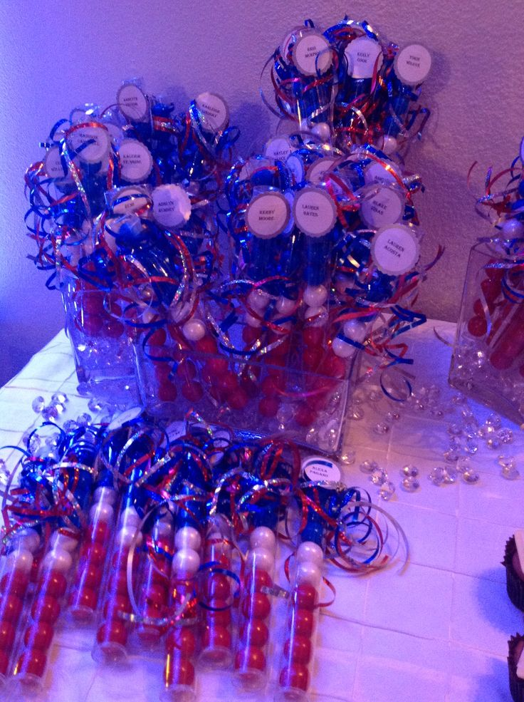 Gum ball spirit sticks with cheerleaders name on tag. We gave these out at our cheer banquet.