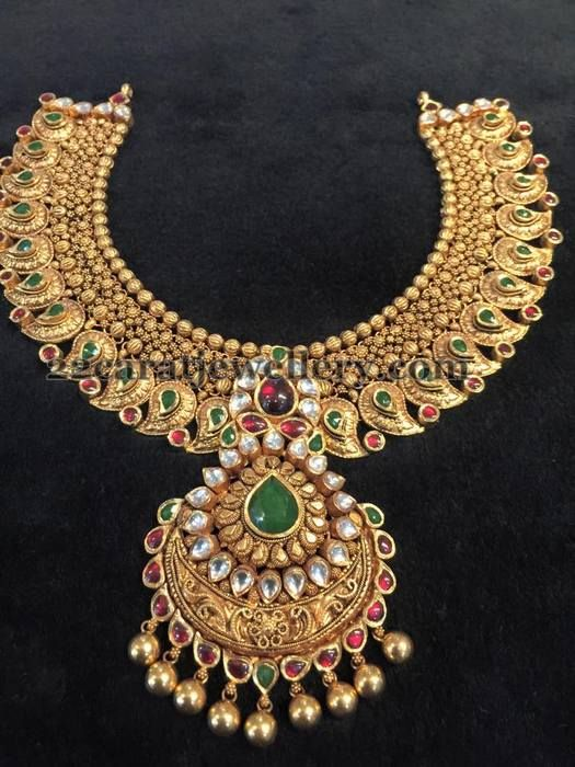 Jewellery Designs: Emeralds Embellished Gold Mango Set