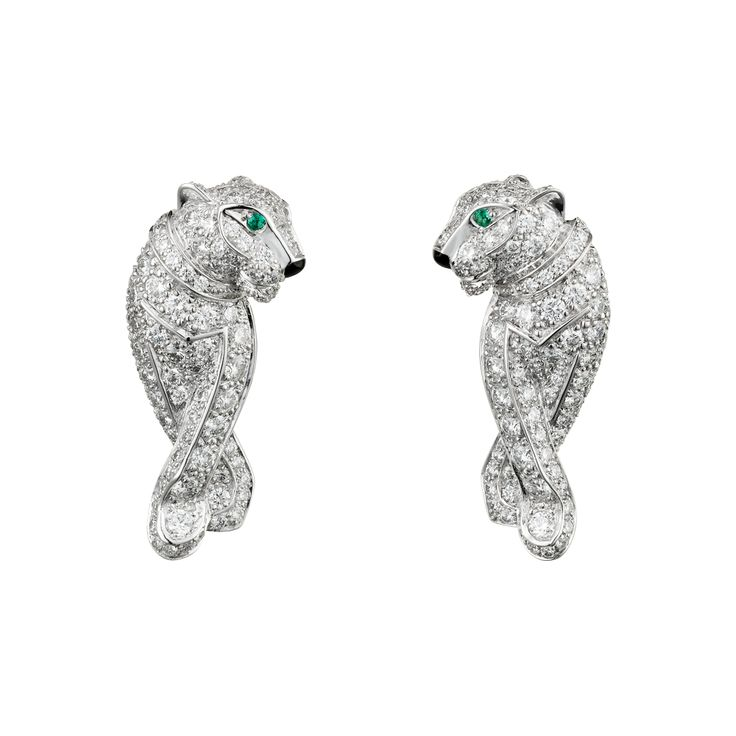 Panthère de Cartier earringsPANTHÈRE DE CARTIER EARRINGS White gold, emerald, onyx, diamonds  REF: N8503400 The Maison's iconic mascot, the panther, first leapt into the world of Cartier jewellery in 1914. Louis Cartier was a pioneer in taming the legendary creature. His associate Jeanne Toussaint went on to make magnificent use of the 18K white gold fully diamond-paved panther motif earrings set with emerald eyes and onyx noses. Dimensions: 22 mm height, 10 mm width.