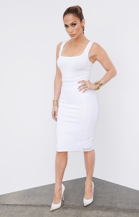 "The American Idol judge looked white hot in an Azzedine Alaïa top, Milly skirt, and Jimmy Choo pumps, which she paired with Vhernier earrings, Jennifer Fisher bracelets, and custom ""I Luh Yah Papi"" necklace by Jane Basch."