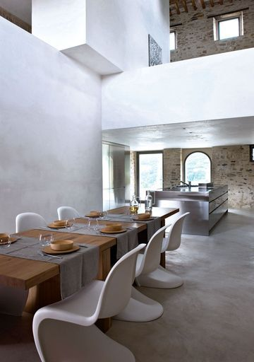 Casa Olivi, a heritage protected building in the Marches of Italy, has been renovated by its owners into a luxurious holiday home. Design by Swiss architects Markus Wespi and Jerome de Meuron - Panton chairs