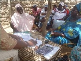 A microcredit client meeting of GRAINE in Burkina Faso. GRAINE provides finanical services directly to groups of poor women in their villages and has a total of 32,032 active clients.