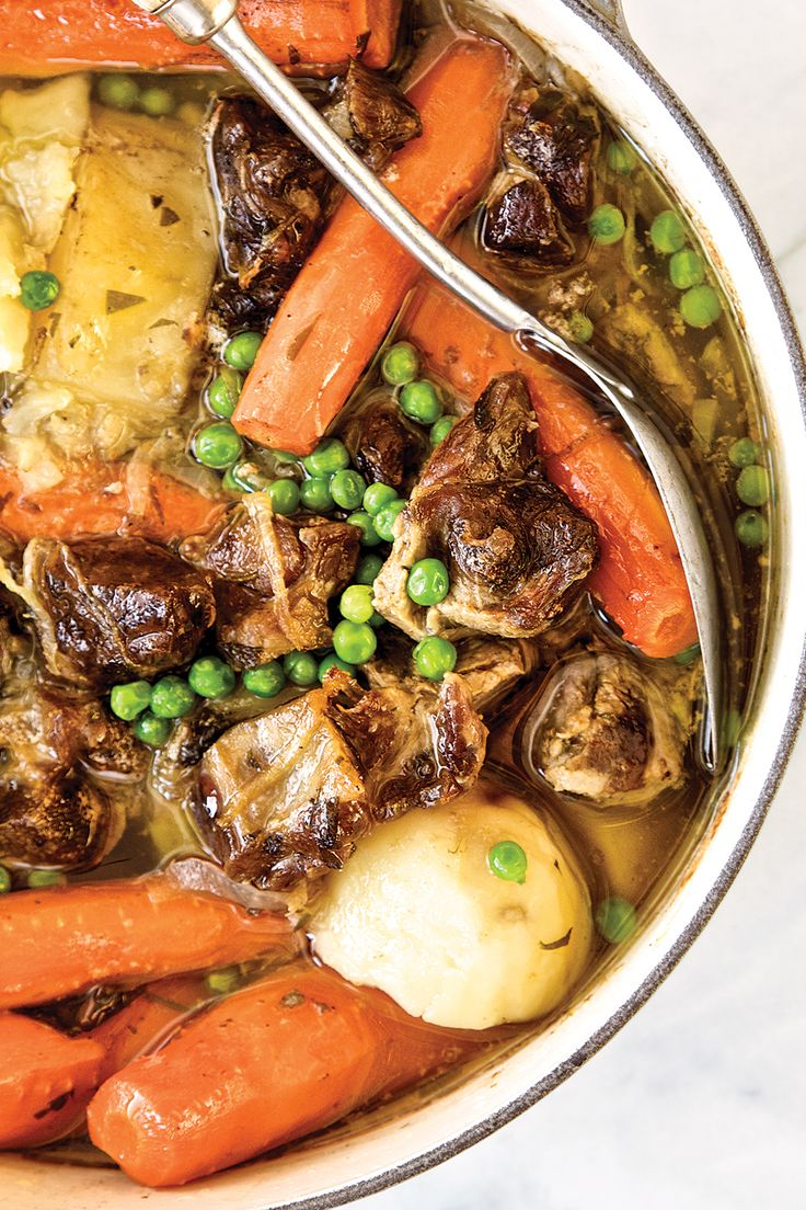 From SAVEUR Issue #168In this traditional warming stew from the Emerald Isle, lamb shoulder is rendered spoon-tender by a simmer and then a long, slow bake with plenty of filling potatoes and aromatic carrots and onions. For bright color and a bit of verdant sweetness, green peas are tossed in toward the end of the cooking.