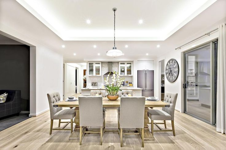 When you have a kitchen that is open to the dining area make sure you clearly define where the kitchen ends and the dining area begins. Buyers dislike when the floor plan runs all the rooms together and it looks like one big space. This interior decor does a great job of that.