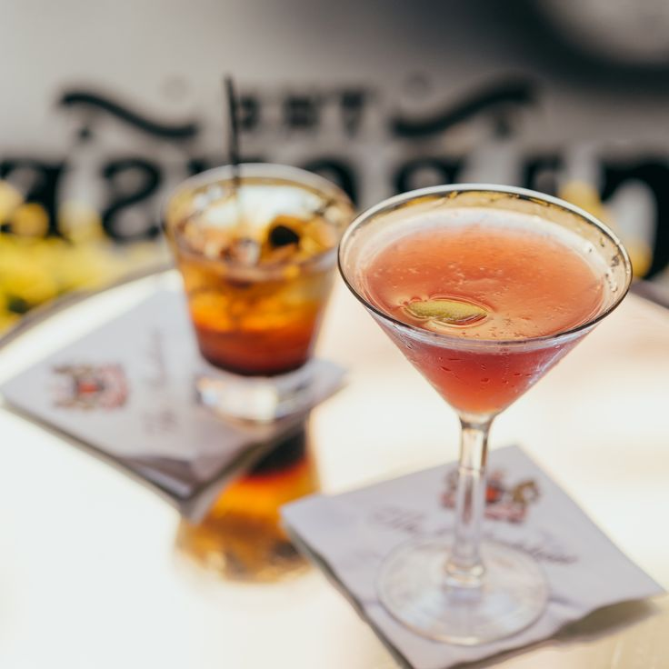 Two cocktails and one entertaining street view are awaiting you at The Carousel Bar & Lounge.