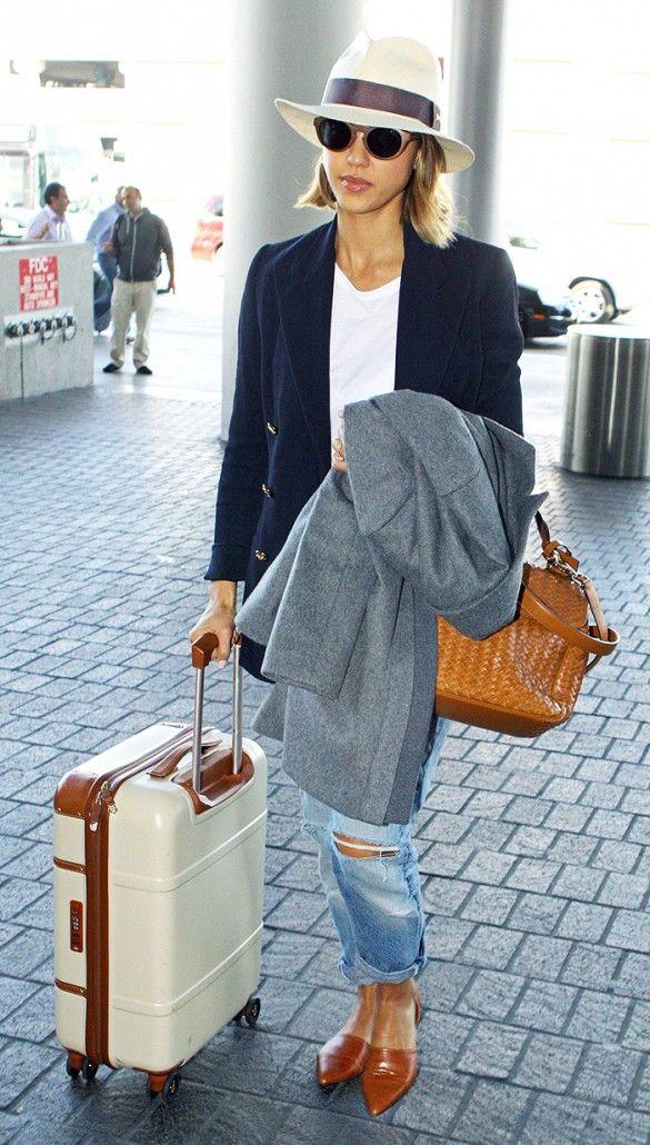 Jessica Alba wears a straw hat with a navy blazer, white T-shirt, boyfriend jeans and Jenni Kayne flats.