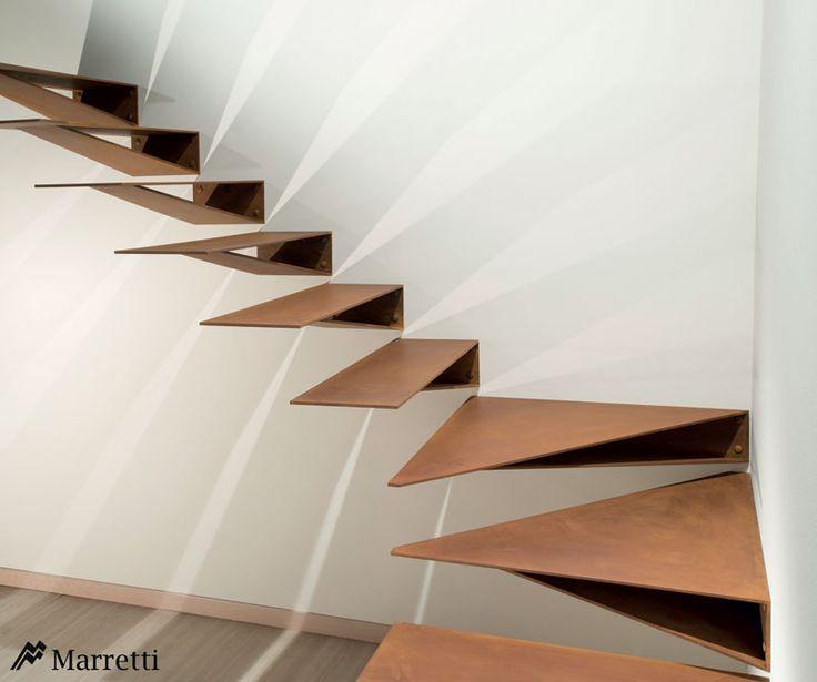 Escalier à éncorbellement ajouré sans contre marches avec marches et garde-corps à lisses horizontales en acier inox.