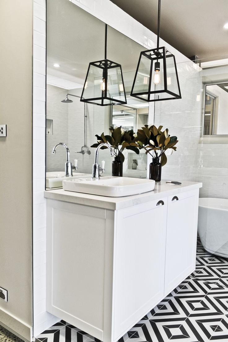 Hotel styling in a bathroom on display in our Sydney MyChoice Design Studio. What do you think? #modern #interiordesign #interior #design #hotel #modernstyle #hotelstyle #tiles #lighting #bathroom #cabinetry #vanity #mirror #flowers #fixtures #bath #styling #decorate #decoration #newhome