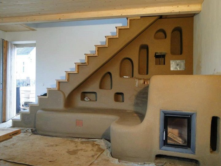 cob house ... love this stairway with seating and alcoves for storage and decor!