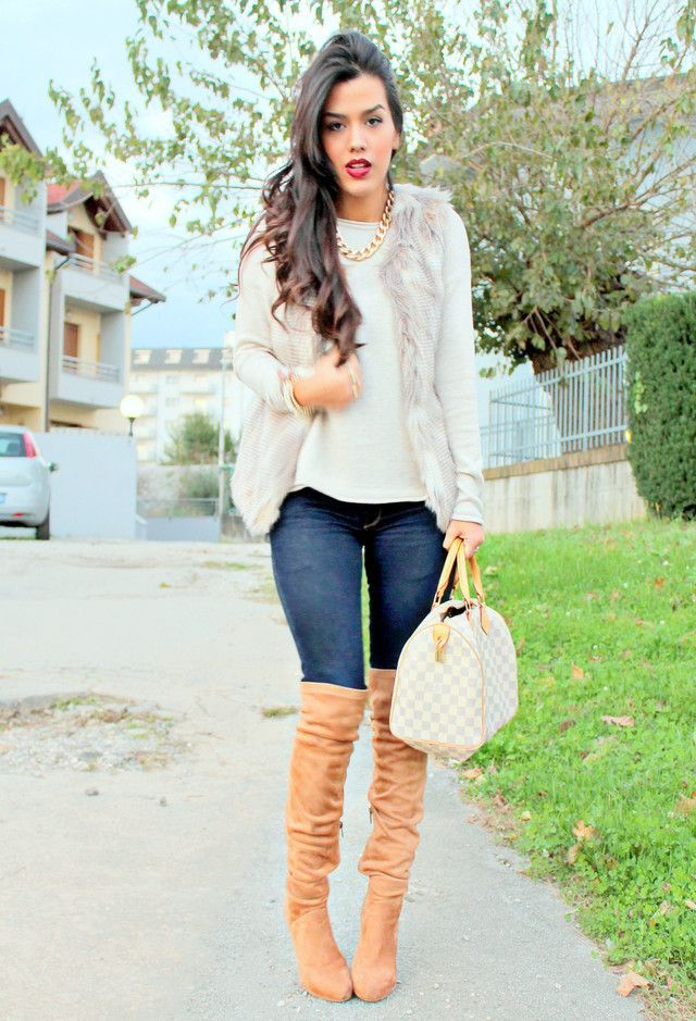 Stay stylish on busy days in a nude fur vest and navy skinny jeans. Tan suede thigh high boots will instantly smarten up even the laziest of looks.  Shop this look for $260:  http://lookastic.com/women/looks/necklace-crew-neck-sweater-vest-skinny-jeans-satchel-bag-over-the-knee-boots/4481  — Gold Necklace  — White Crew-neck Sweater  — Beige Fur Vest  — Navy Skinny Jeans  — White Plaid Leather Satchel Bag  — Tan Suede Over The Knee Boots