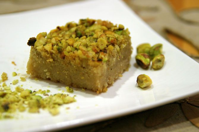 """Basbousa means """"just a kiss"""" in Arabic. This sweet cake differs from country to country- i make a similiar cake using lemons and semolina myself, and I am itching to have a bash at this using my newly found quinoa flakes."""
