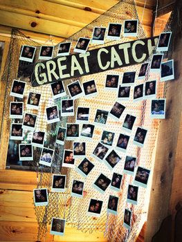 Great catch. A fishing net displayed Polaroids of the couple. Great for low country boil theme.