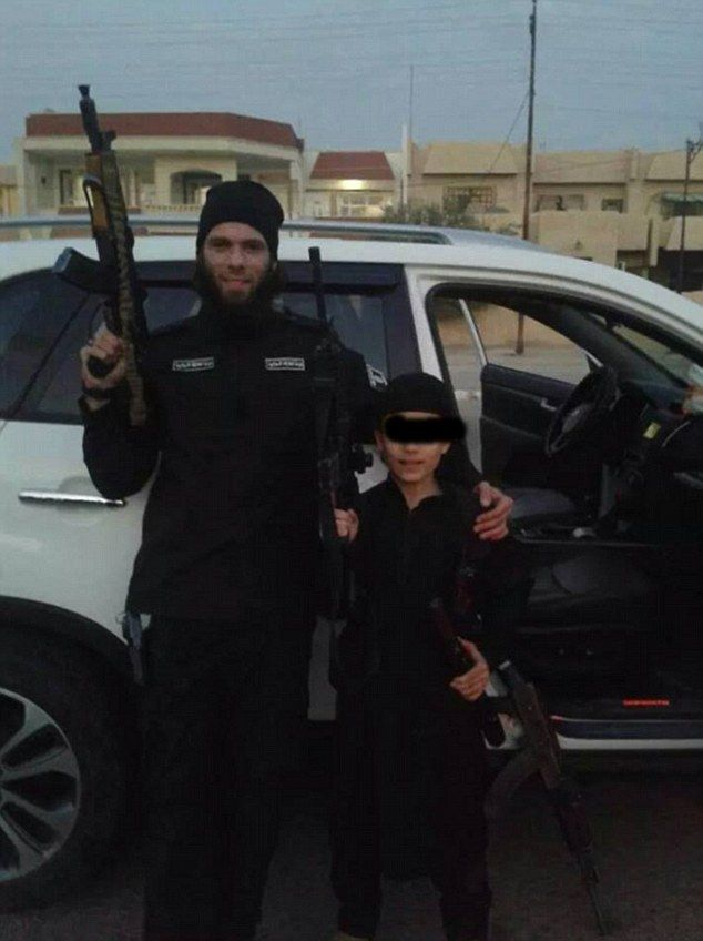 German jihadi Mario Sciannimanica is pictured here with a young boy in Syria. Mario's mother was contacted by terrorists earlier this year to say he had been killed in an American air strike