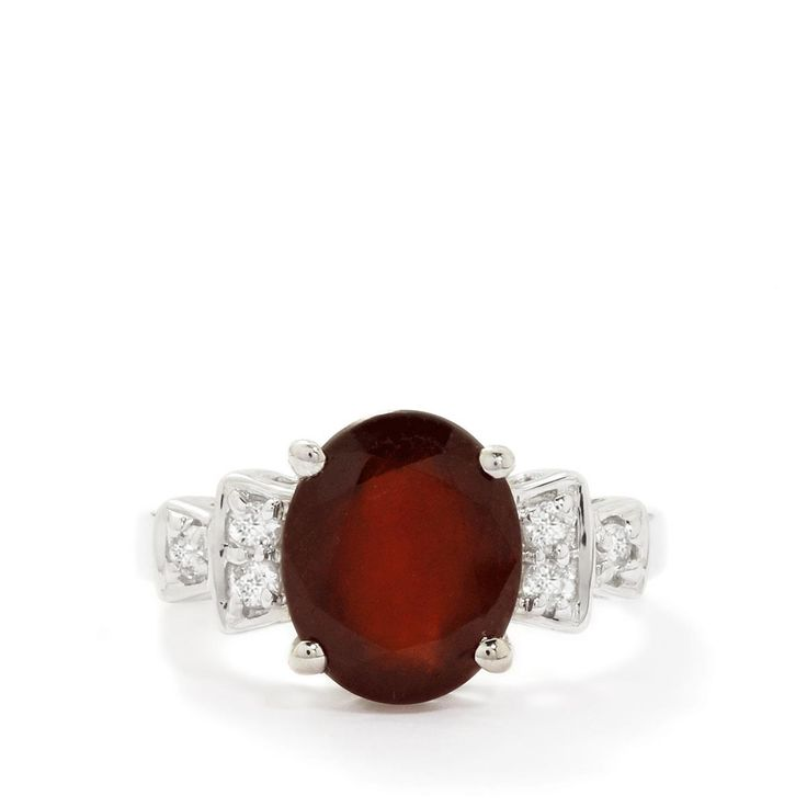 A designer Ring from the Annabella collection, made of Sterling Silver featuring 3.89cts of beautiful Ciana Hessonite Garnet and White Topaz.
