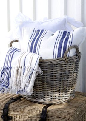 grey washed baskets with blue and white cotton comforts !